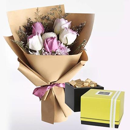 زهور بنفسجية وبيضاء وشوكولاتة باتشي: شوكولاتة عيد الحب