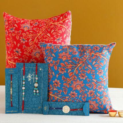 Family Rakhi Set With 2 Floral Print Cushions
