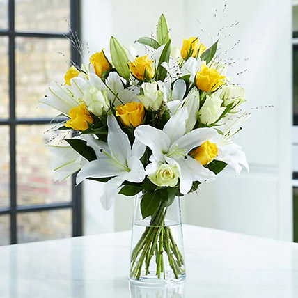 Lilies And Yellow Roses